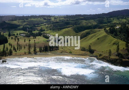 South Pacific island. Australian territory. Aerial shot. Sea. Over Cemetery. Golf course. Contours of volcanic island. - Stock Photo