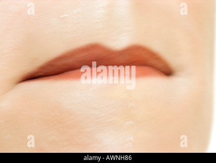 Close up of woman's mouth. - Stock Photo