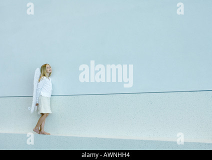 Girl wearing angel wings - Stock Photo