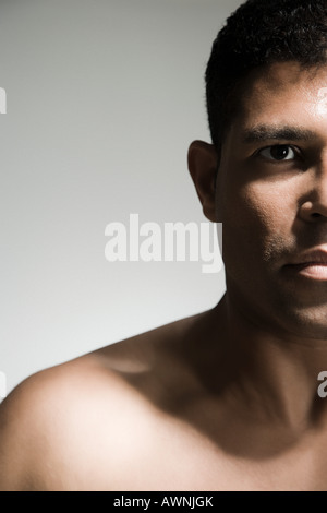 Cropped head and shoulders of a man - Stock Photo