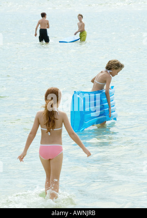 Children playing in water at the beach - Stock Photo