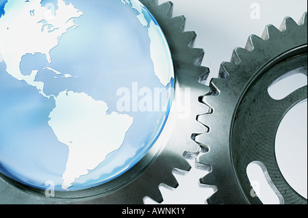 Planet earth and machine cogs - Stock Photo