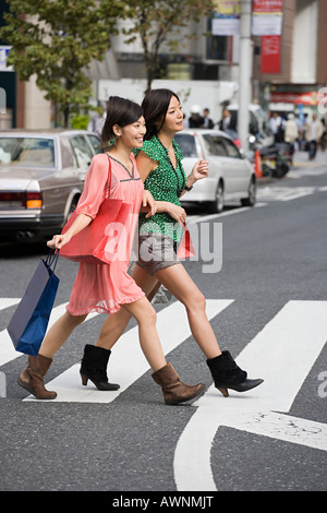Friends shopping in tokyo - Stock Photo