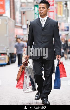 A man shopping in tokyo - Stock Photo
