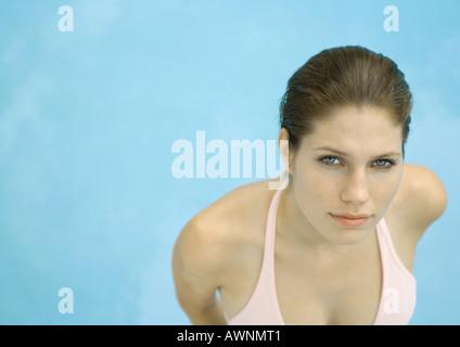 Woman wearing bikini, water in background, high angle view