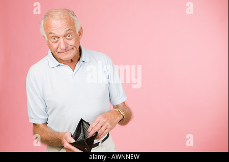 Man with empty wallet - Stock Photo