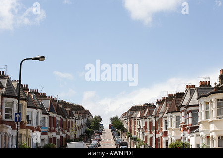 Row of terraced houses on a hill - Stock Photo