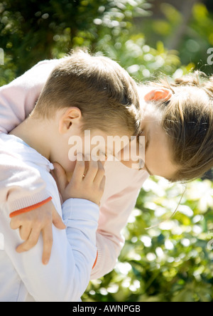 Girl comforting little brother - Stock Photo