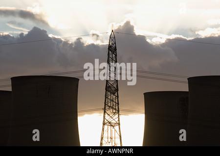 Electrical tower and smokestacks - Stock Photo