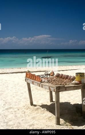 Stall selling shells on the beach at Nungwi on the north west coast of Zanzibar Island, Tanzania - Stock Photo