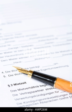 Fountain pen laying on top of a document - Stock Photo
