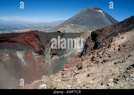 Red crater in front of Mt. Ngauruhoe, Tongariro National Park, North Island, New Zealand, Oceania - Stock Photo