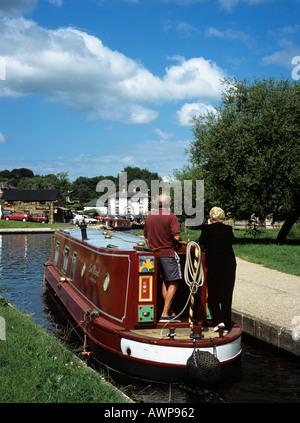 Trevor Wrexham North Wales UK Red Narrow Boat Approaching Trevor Basin on Llangollen branch of 'Shropshire Union' - Stock Photo