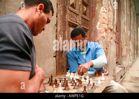 Two men playing chess in the streets, Havana, Cuba, Caribbean - Stock Photo
