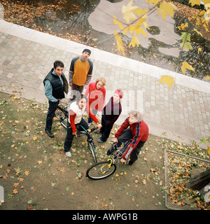 Young people, two with bikes, elevated view - Stock Photo