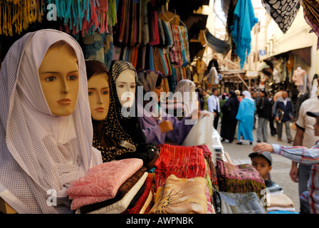 Veiled mannequin in a shop window in the historic centre of Fes, Morocco, North Africa - Stock Photo