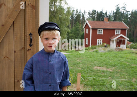 Boy dressed as a literary character at film shooting location and former home of Astrid Lindgren in Katthult/Gibberyd, - Stock Photo