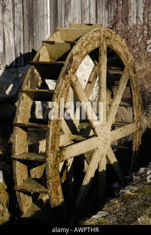 Wooden mill wheel at an old sawmill in Nussdorf, Bavaria, Germany, Europe - Stock Photo