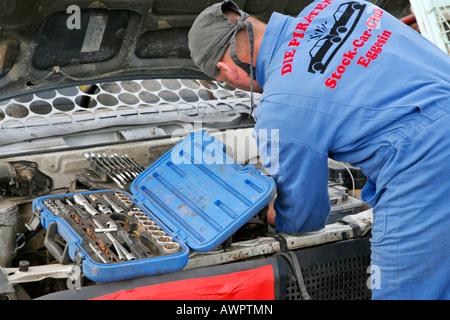 Stock Car Club member repairs a car - Stock Photo