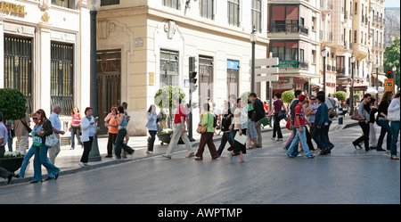 People crossing the street, Granada, Andalusia, Spain - Stock Photo