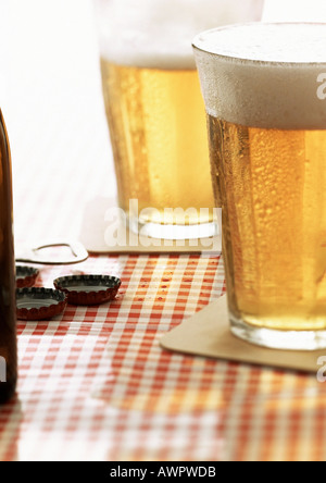 Two glasses of beer on cafe table, close-up - Stock Photo