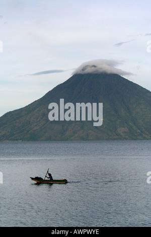 GUATEMALA Scenes on Lake Atitlan Fisherman in dugout canoe photo C Sean Sprague 2006 - Stock Photo