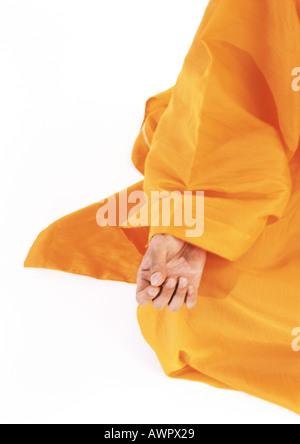 monk meditating in lotus position sunrise golden hall