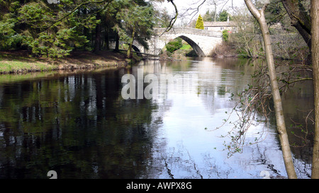 a river view of the Froggatt bridge over the river Derwent at Froggatt,Derbyshire England. - Stock Photo