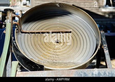 Spiral machine for gold washing, Dawson City, Yukon Territory, Canada - Stock Photo