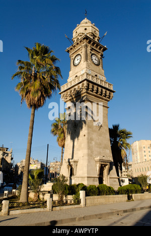 Clock tower in the old town of Aleppo, Syria - Stock Photo