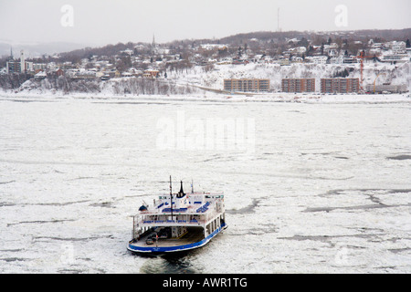 Ferry crossing the icy St. Lawrence River (French: fleuve Saint-Laurent), Québec City, Québec, Canada - Stock Photo
