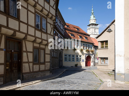 Fachwerk-style half-timbered houses in the historic city centre and the tower of St. Boniface's Church in the background, - Stock Photo