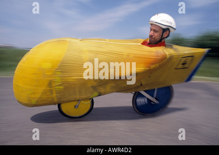 Credit line mandatory John Angerson Competitors in a human powered bicycle race - Stock Photo