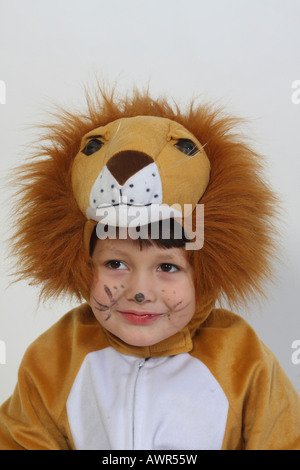 Five year old boy wearing a lion costume - Stock Photo