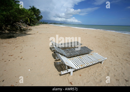 Sunloungers on a deserted beach in Tangalle, Sri Lanka, Asia - Stock Photo