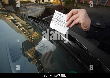 Traffic warden put a fine on the front shield - Stock Photo