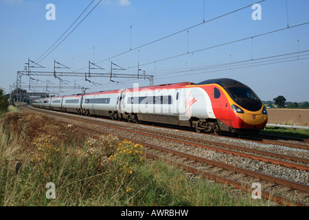 Virgin Trains class 390 Pendolino express train on London bound service on the West Coast Mainline Trent Valley - Stock Photo