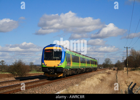 Arriva Cross Country formerly Central trains class 170 636 passes Mill Lane farm and foot crossing Rearsby Leicestershire. - Stock Photo