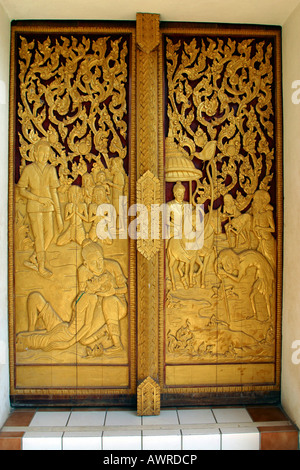 Laos Vientiane Wat That Fun carved wooden door - Stock Photo
