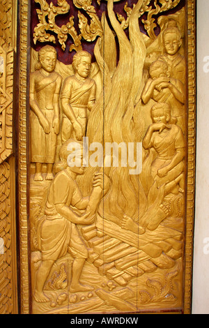 Laos Vientiane Wat That Fun carved wooden window cremation scene - Stock Photo