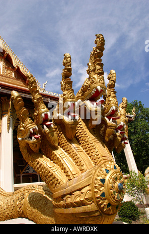 Laos Vientiane Wat That Fun serpents guarding entrance - Stock Photo