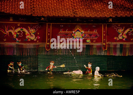 Water Buffalo and a village scene inside the THANG LONG WATER PUPPET THEATRE HANOI VIETNAM - Stock Photo