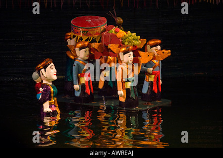 Carrying goods in a scene inside the THANG LONG WATER PUPPET THEATRE HANOI VIETNAM - Stock Photo