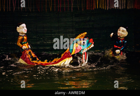 Riding a DRAGON during the preformance at the THANG LONG WATER PUPPET THEATRE HANOI VIETNAM - Stock Photo