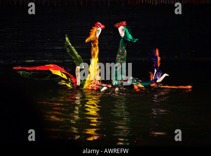 Cranes float on the water during the show at the THANG LONG WATER PUPPET THEATRE HANOI VIETNAM - Stock Photo