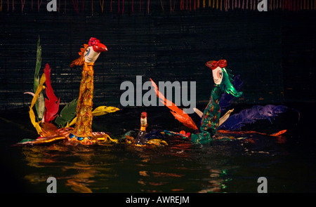 Cranes float on the water during the performance at the THANG LONG WATER PUPPET THEATRE HANOI VIETNAM - Stock Photo