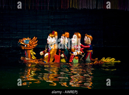 Characters ride a DRAGON during the performance at the THANG LONG WATER PUPPET THEATRE HANOI VIETNAM - Stock Photo