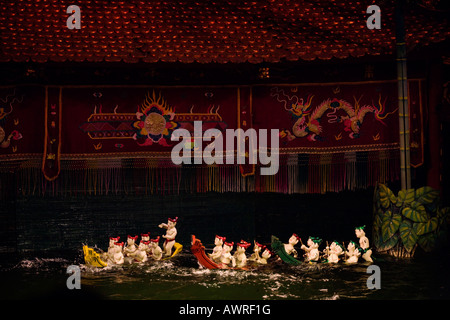 A boat race during the performance at the THANG LONG WATER PUPPET THEATRE HANOI VIETNAM - Stock Photo