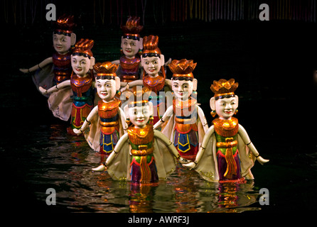 Dancing women during the performance at the THANG LONG WATER PUPPET THEATRE HANOI VIETNAM - Stock Photo
