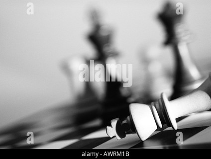 Chess pieces on chessboard, b&w. - Stock Photo